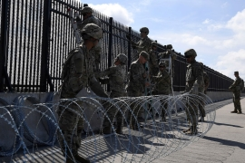 Army engineers installing concertina wire on the Anzalduas International Bridge along the southern border of the United States in McAllen, Texas, US [US Air Force/Handout via Reuters]