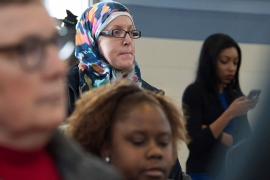 A volunteer at the Islamic Center of Cedar Rapids listens during a campaign rally before the 2016 Iowa caucus [File: Jim Watson/AFP/Getty Images]