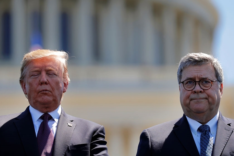 United States President Donald Trump and US Attorney General William Barr attend the 38th Annual National Peace Officers Memorial Service on Capitol Hill [File: Carlos Barria/Reuters]