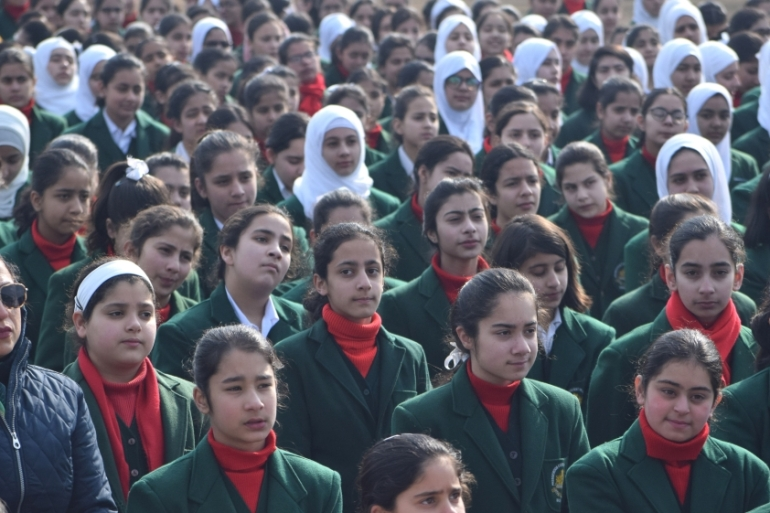 Students in neatly creased uniforms on Monday attended classes after a lengthy break [Shuaib Bashir/Al Jazeera]