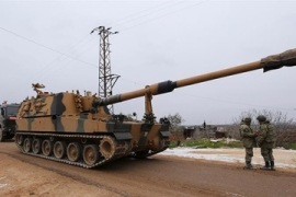 Syrian rebels fight to hold onto key northern town