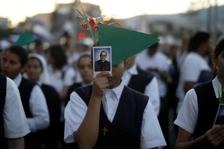 Nuns participate in a procession to commemorate the 39th anniversary of the murder of Archbishop Oscar Romero in San Salvador, El Salvador, March 23, 2019 [File: Jose Cabezas/Reuters]