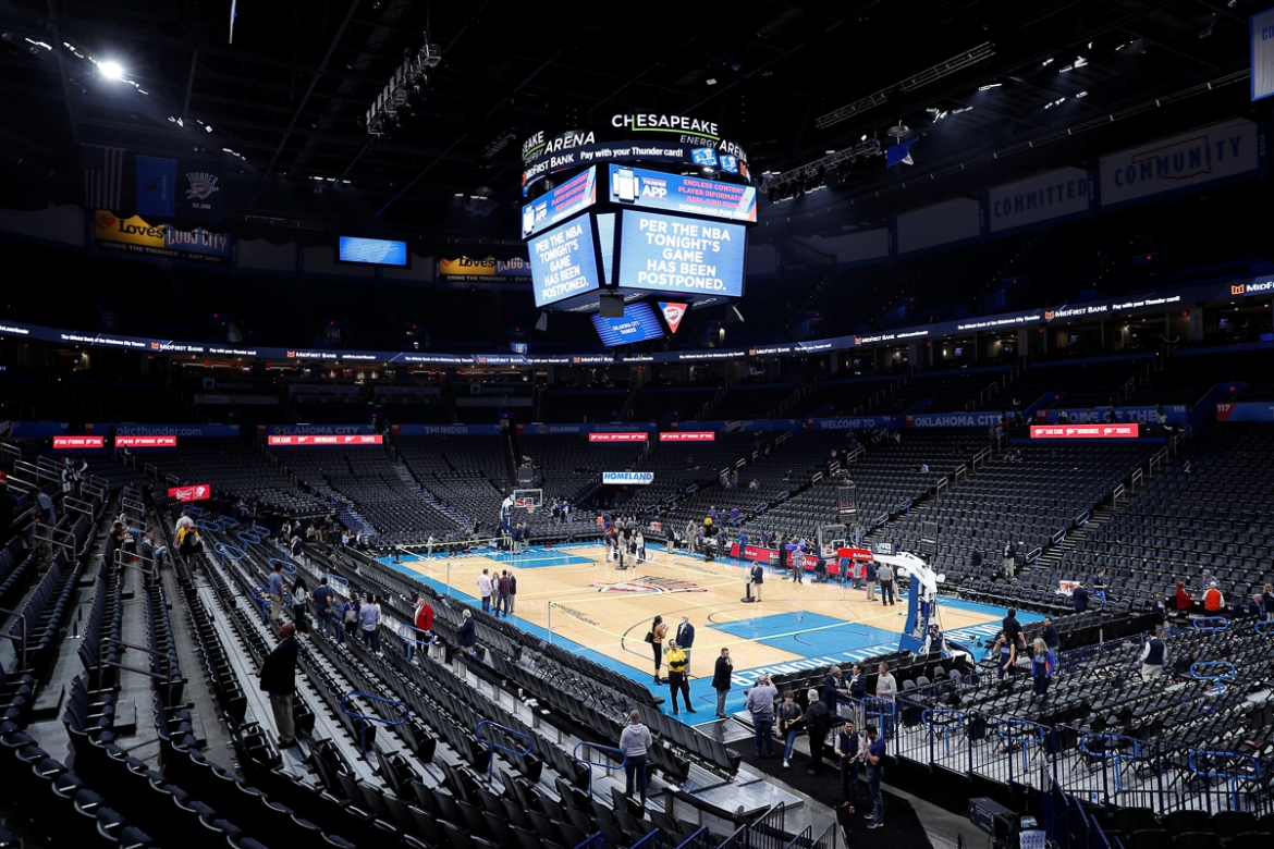 Fans leave after an announcement that the NBA fixture between Oklahoma City Thunder and Utah Jazz was cancelled just before the tip-off at Chesapeake Energy Arena. [Alonzo Adams/USA Today Sports via Reuters]