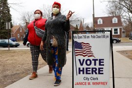 Voters arrive with masks in light of the coronavirus COVID-19 health concern at Warren E Bow Elementary School in Detroit, Michigan, Tuesday. [Paul Sancya/AP Photo]