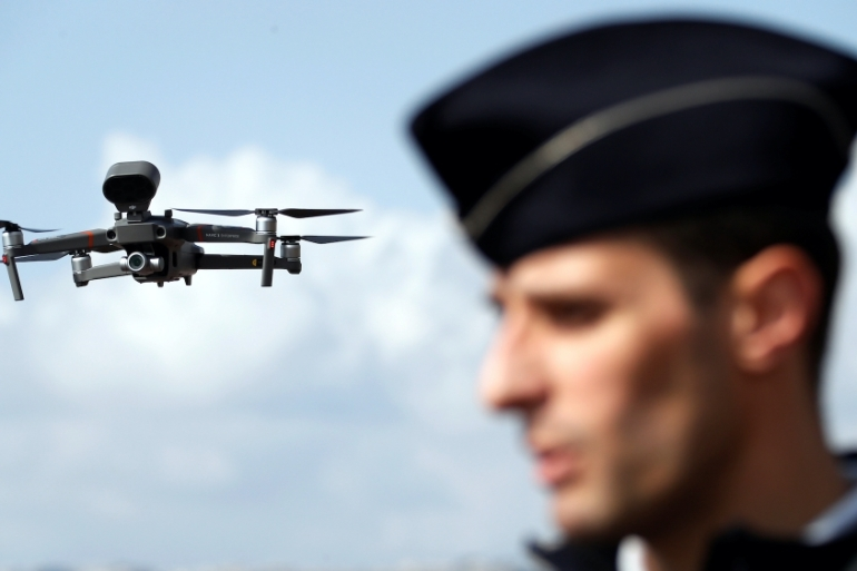 A drone, seen over the Promenade des Anglais, is used by French police to remind citizens of the coronavirus confinement measures in Nice, France [Eric Gaillard/Reuters]