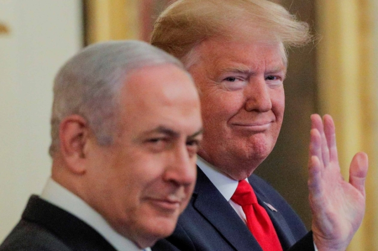 US President Donald Trump waves next to Israeli Prime Minister Benjamin Netanyahu prior to presenting his Middle East plan at the White House on January 28, 2020 [Reuters/Brendan McDermid]