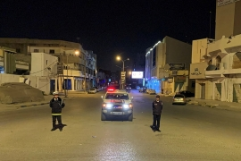 Police in the western city of Misrata monitor a curfew imposed as part of precautionary measures against the coronavirus [Ayman Al-Sahili/Reuters]
