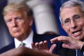 Dr Anthony Fauci speaks as US President Donald Trump listens during the daily press briefing on the Coronavirus pandemic situation at the White House [File: Brendan Smialowski/AFP]