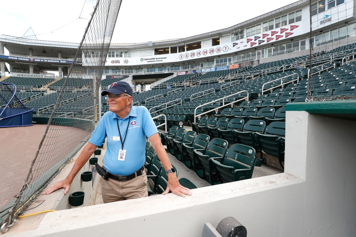 Hammond Stadium usher Ken Trammell looks out on an empty stadium in Fort Myers, Florida. Major League Baseball has suspended the rest of its spring training game schedule because of the coronavirus outbreak. MLB is also delaying the start of its regular season by at least two weeks. [Elise Amendola/AP Photo]