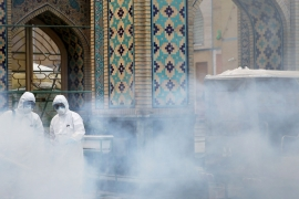 Members of a medical team spray disinfectant to sanitise the outdoor space at Imam Reza's holy shrine, following the coronavirus outbreak, in Mashhad, Iran on February 27, 2020 [West Asia News Agency via Reuters]