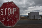 A weathered stop sign in both English and the Inuit language Inuktitut is shown in Iqaluit, Nunavut [File: Andy Clark/Reuters]