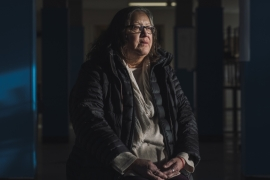 Alsena White, 67, sits in what was a dining hall when she was a student of Blue Quills Residential School in St Paul, Alberta [Amber Bracken/Al Jazeera]