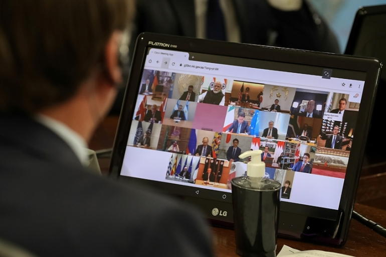 Brazil's President Jair Bolsonaro takes part in a video-link G20 leaders conference on COVID-19 on Thursday that produced the most concilatory language on trade the group has produced in years [Marcos Correa/Brazilian Presidency/Handout via Reuters]