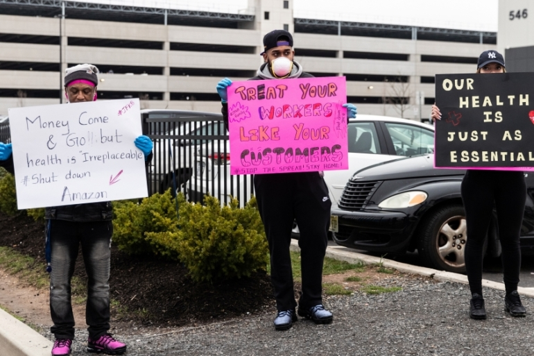 Protesters hold signs at an Amazon building during the outbreak of coronavirus, in Staten Island, NY, the United States, where delivery drivers, grocery store clerks, and shelf stockers have kept food flowing to people abiding by social distancing restrictions [File: Jeenah Moon/Reuters]