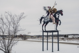 A sculpture stands on the snowy grounds of Saddle Lake Cree Nation in Alberta [Amber Bracken/Al Jazeera]