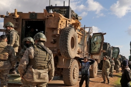A Turkish military convoy is seen parked near the town of Batabu on the highway linking Idlib to the Syrian Bab al-Hawa border crossing with Turkey [Aaref Watad/AFP]