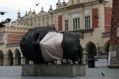 A sculpture Eros Bendato with a mock mask is seen on the main square during the coronavirus disease (COVID-19) lockdown in Krakow, Poland, on March 23, 2020 [Jakub Wlodek/Agencja Gazeta via Reuters]