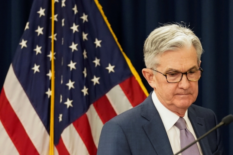 Appearing on a network morning show on Thursday, Federal Reserve Chairman Jerome Powell gave a message of first containing the pandemic, then opening for business - in contrast to Trump's call to get economy 'roaring' by Easter [File: Kevin Lamarque/Reuters]
