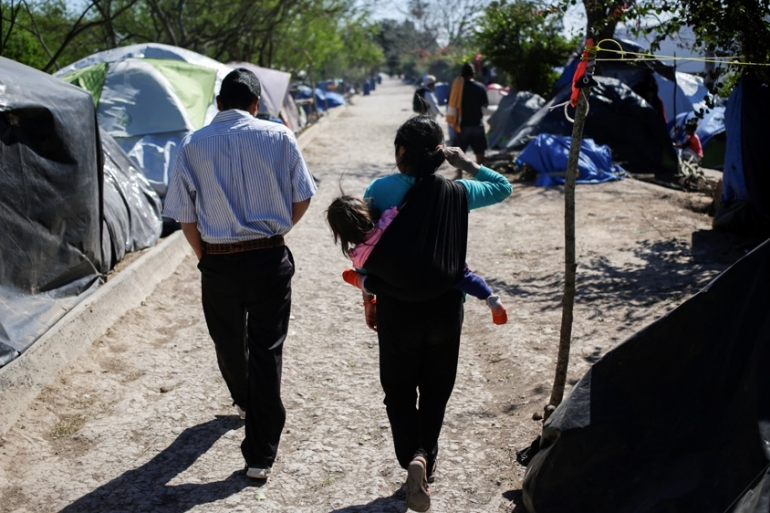 Health workers are preparing for COVID-19 cases to reach the migrant and asylum seeker camps along Mexico's US border. [Daniel Becerril/Reuters]