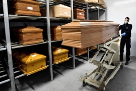 Coffins of people who have died from coronavirus disease (COVID-19) are seen in a crematorium in the town of Serravalle Scrivia, Alessandria, Italy, March 23, 2020. REUTERS/Flavio Lo Scalzo [Reuters]