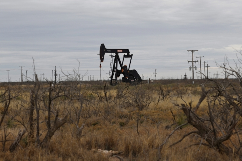 A pump jack operates in the Permian Basin oil and natural gas production area near Odessa, Texas, in the United States [File: Nick Oxford/Reuters]