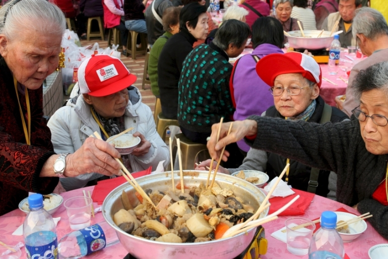 Not only have media and social organisations begun to launch these campaigns to encourage people to adopt the use of serving utensils, but local governments are also springing into action [File: YM Yik/EPA]