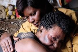 Susan Kigula meets her friend and ex-prisoner, Justine [Al Jazeera]
