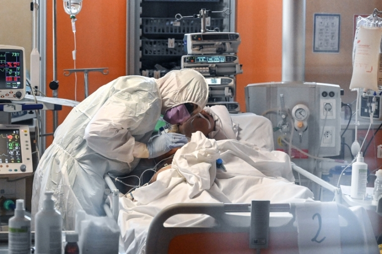 A medical worker in protective gear tends to a patient at the new intensive care unit at the Casal Palocco hospital near Rome.
