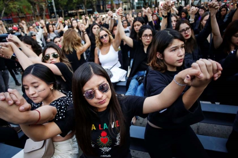 Women protest against gender violence and femicides at Angel de la Independencia monument in Mexico City, Mexico [Gustavo Graf/Reuters]