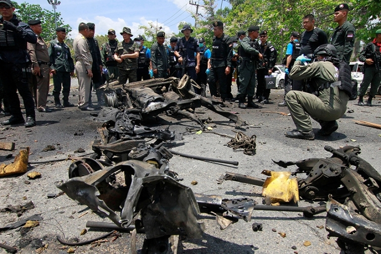 Security personnel inspect site of a car bomb after if exploded in front of the government's Southern Border Provinces Administrative Centre in Yala, Thailand [Surapan Boonthanom/Reuters]