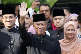 Muhyiddin's eight-month-old administration has clung on with a two-seat majority in Parliament [Reuters]