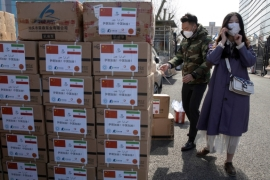 Workers from a charity foundation prepare boxes of disinfectant tablets to be donated to Iran in Beijing last week [File: Ng Han Guan/AP]