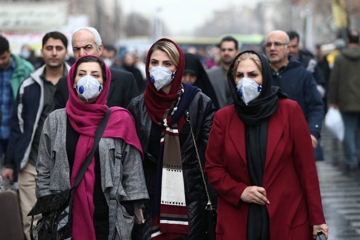 Iranian women walk at the Grand Bazaar in Tehran, Iran, after 15 people were reported dead from the coronavirus. [Nazanin Tabatabaee/WANA/Reuters]