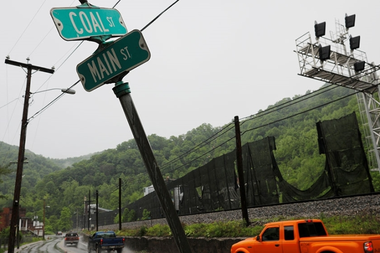 Cars pass the intersection of Coal Street and Main Street in Keystone, West Virginia [Brian Snyder/Reuters]