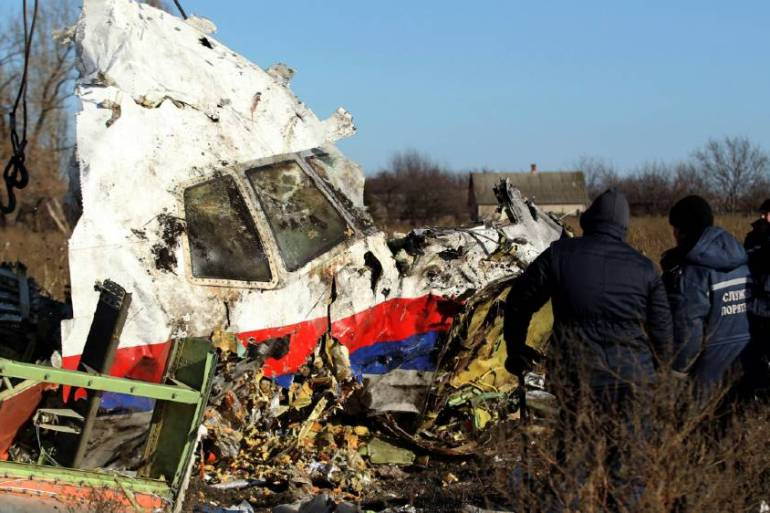 Local workers transport a piece of wreckage from Malaysia Airlines flight MH17 at the site of the plane crash near the village of Hrabove (Grabovo) in Donetsk region, eastern Ukraine on November 20, 2014 [File: Antonio Bronic/Reuters]