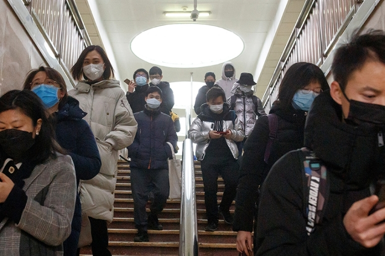 People in Beijing are slowly returning to work and daily activities as the number of new coronavirus infections fall [File: Thomas Peter/Reuters]