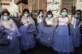 Weddings continue apace in Gaza, although attendees are taking some precautions [Ashraf Amra/Al Jazeera]