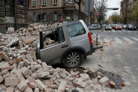 A destroyed car in Zagreb, Croatia is seen following the earthquake [Darko Bandic/AP Photo]