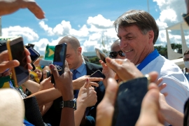 Bolsonaro meets supporters during a protest against Brazil's Congress and Supreme Court, in front of the Planalto Palace on March 15, amid the coronavirus outbreak [Adriano Machado/Reuters]