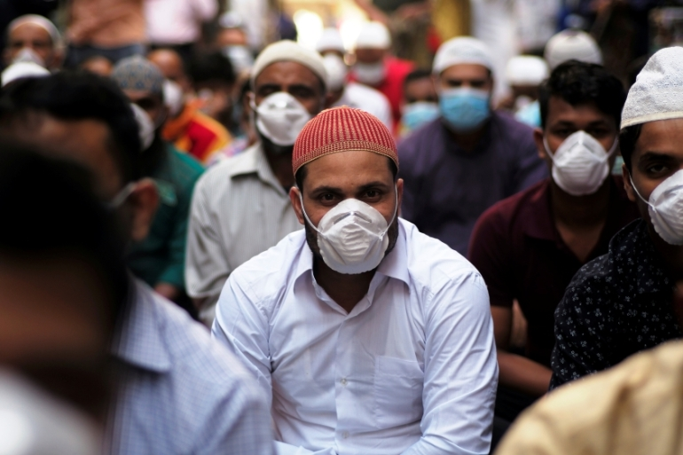 Muslims wear masks as they pray during Friday prayers in Manama, Bahrain [File: Hamad I Mohammed/Reuters]