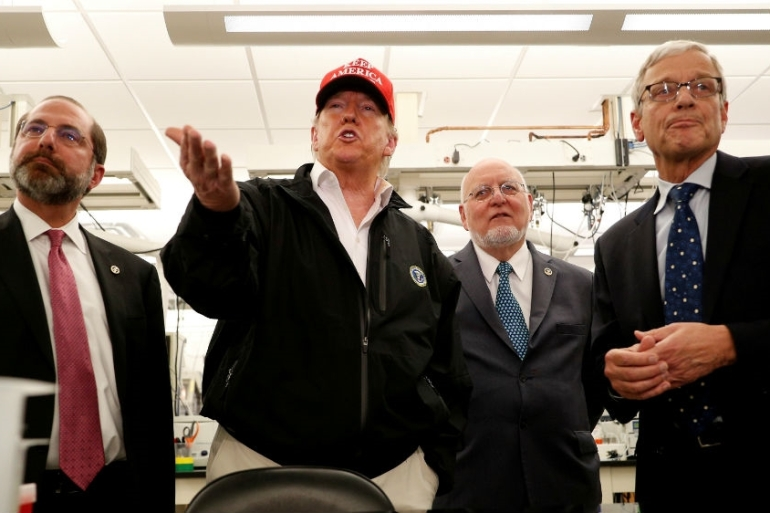The administration of US President Donald Trump, seen visiting the CDC headquarters, axed a key CDC public health role in Beijing, according to Reuters [File: Tom Brenner/Reuters]