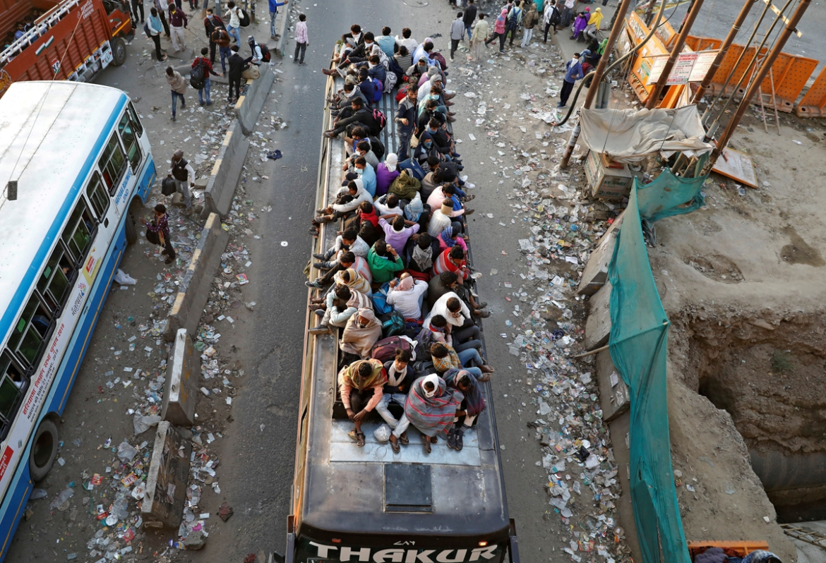 The workers started fleeing New Delhi after Prime Minister Narendra Modi announced the lockdown, which effectively put millions of Indians living off daily earnings out of work. [Adnan Abidi/Reuters]