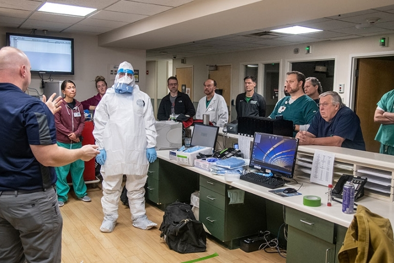 Members of the West Virginia National Guard''s special response teams provide hands-on Personal Protective Equipment instruction to the staff of Cabell Huntington Hospital to help prepare the facility for potential future cases of novel coronavirus in Huntington, West Virginia [Handout/US Army National Guard/Edwin L Wriston/Reuters]