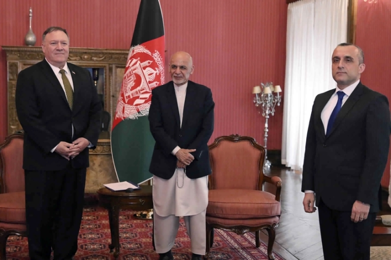 Pompeo (left) met with Afghan President Ashraf Ghani (centre) and first Vice President Amrullah Saleh, at the Presidential Palace in Kabul on Monday [Afghan Presidential Palace via AP]