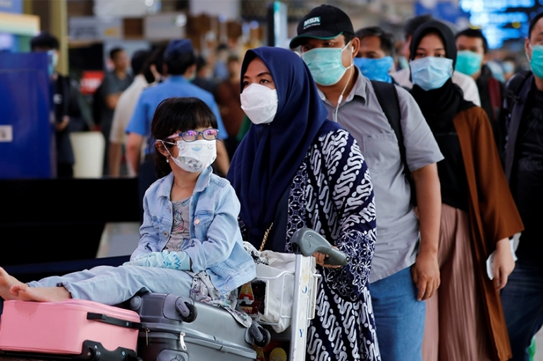 So far, more than 351,00 people have been infected by the coronavirus, and more than 15,330 have died, according to a Reuters tally [File: Willy Kurniawan/Reuters]