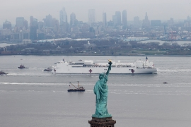 US Navy hospital ship Comfort passes the Statue of Liberty as it enters New York Harbor. The ship arrived with 1,000 beds to relieve pressure on overwhelmed hospitals. [Mike Segar/Reuters]