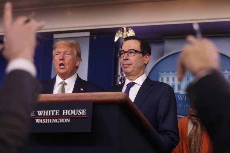 US President Donald Trump and Treasury Secretary Steven Mnuchin answer questions during the Trump administration's daily coronavirus briefing at the White House [File: Jonathan Ernst/Reuters]