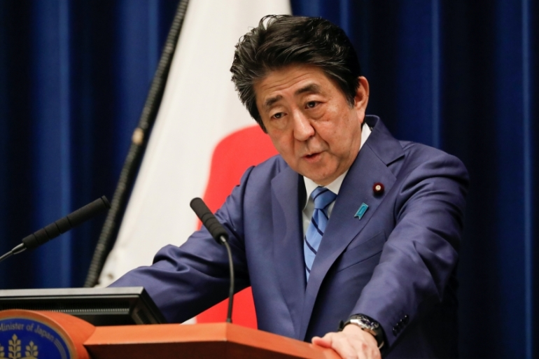 Japanese Prime Minister Shinzo Abe is planning a package of economic stimulus measures, which he has described as 'bold and unprecedented', to combat the effects of the coronavirus pandemic in his country [File: Issei Kato/Reuters]