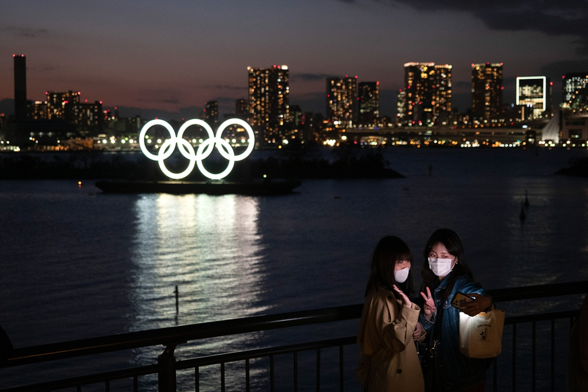 Top Japanese government officials said they were determined to hold 'safe and secure' Olympics on schedule after US President Donald Trump said Tokyo should consider delaying them by a year because of the pandemic. [Jae C Hong/AP Photo]