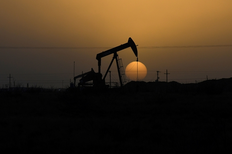 A pump jack operates at sunset in Midland, Texas in the United States [Nick Oxford/Reuters]